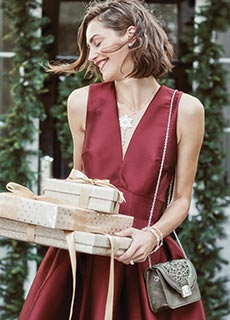Model carrying gifts for all