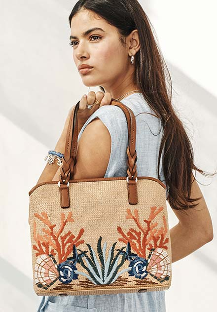 Model With Coastal June Straw Tote