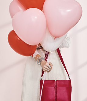 Model With Balloons and Brighton Products