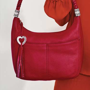 Model holding Red Handbag