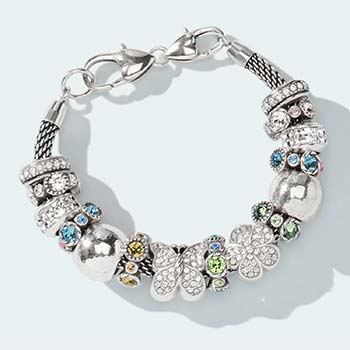 Charm bracelet with flower and butterfly beads