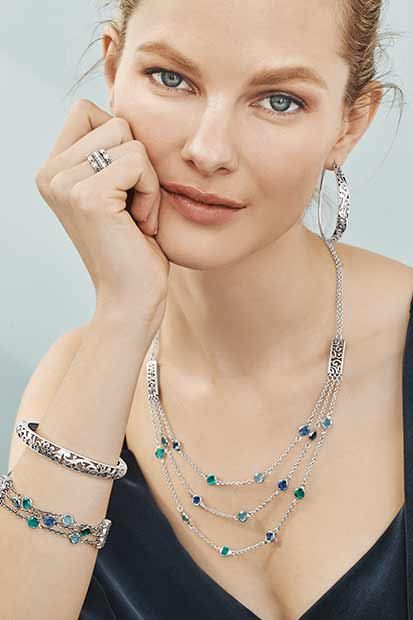 Model wearing Elora Jewelry in Blue