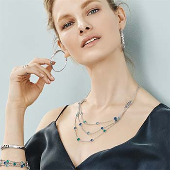 Model wearing Elora Gems Jewelry in Blue