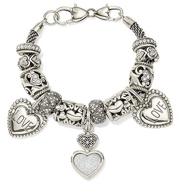 Silver bracelet with different love charms and beads