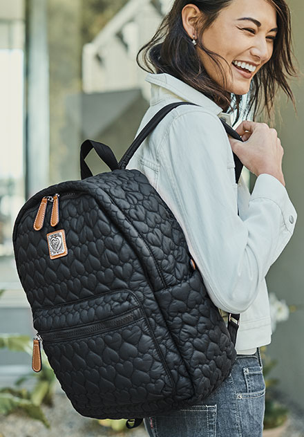 Model Wearing Kirby Carry-On Backpack