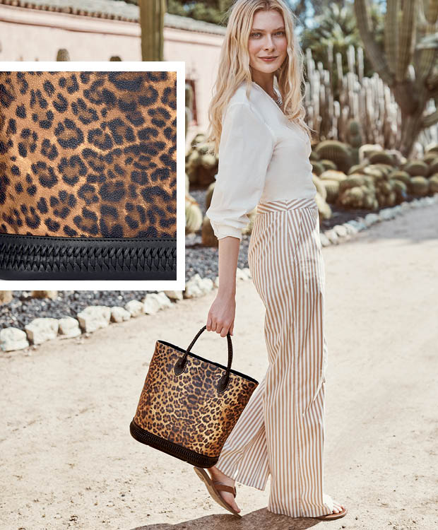Model With leopard print handbag