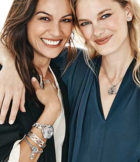friends wearing silver jewelry and watch