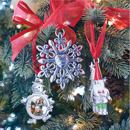 snowman, snowflake and santa's helper ornaments on christmast tree