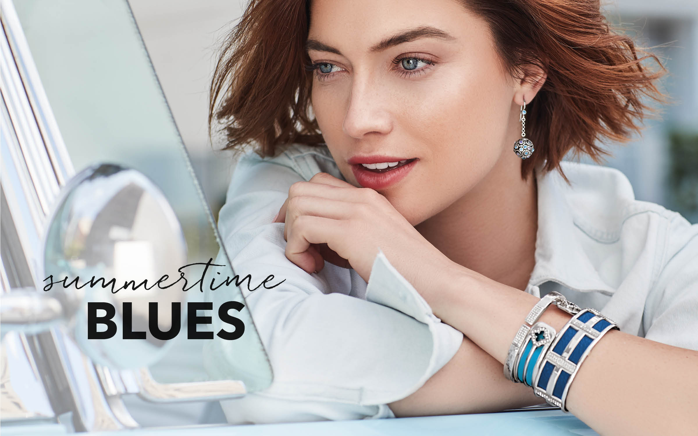 Model wearing Christo cuffs with blue leather inserts and Meridian bangle